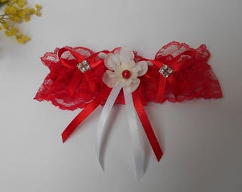 Red and white garter with artificial Larkspur