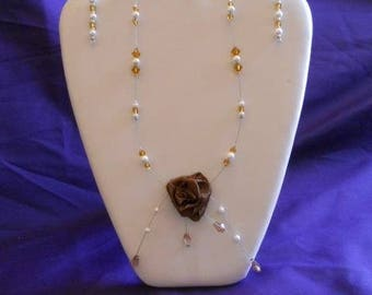 set in Brown satin flower and pearls