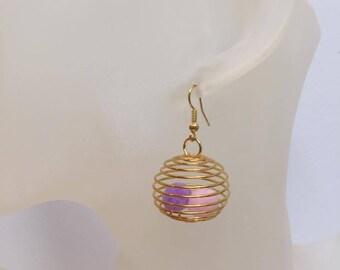 Gilded cage & tassel earrings