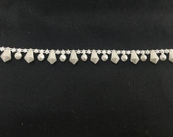 Pearly white plastic beaded Ribbon