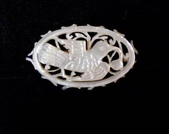 Vintage carved mother of pearl brooch