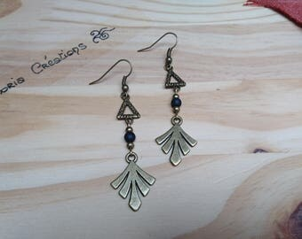 Pair of leaf and black triangle earrings