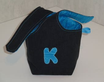 Knotted black recycled denim, K, inside pouch cotton turquoise pattern