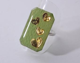 Hearts ring, Golden on khaki background