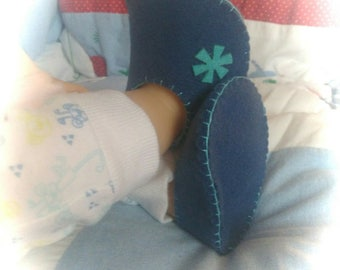 Blue and turquoise felt baby shoes.