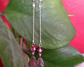 Metal feather earrings.