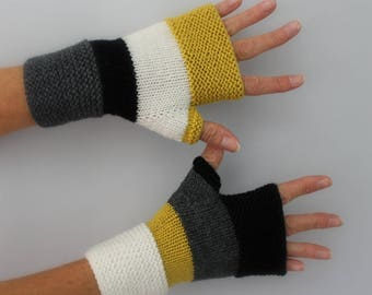 handmade black, mustard yellow, ivory white knitted mittens and charcoal gray