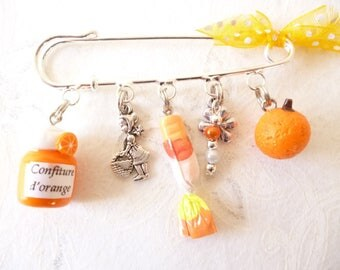 "brooch ""back to childhood orange"" charms"