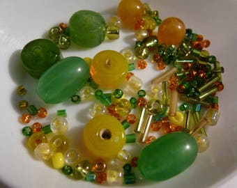 Set of beads, green, orange, yellow mixed - shapes and sizes vary