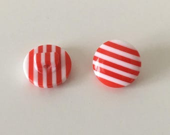 Red white striped button on foot