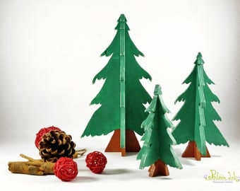 A trio of hand-decorated wooden trees