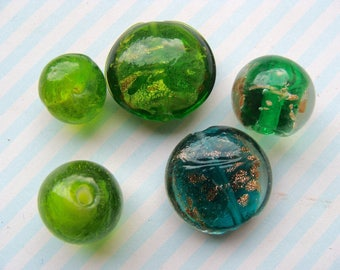 Set of 5 Green Indian glass beads forms various 10 to 20mm diam.
