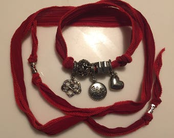 Red silk ribbon wrap bracelet or necklace with charms