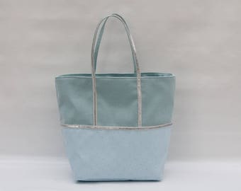The bi-color sky blue cotton and printed diamond Tote with a silver sequin trim