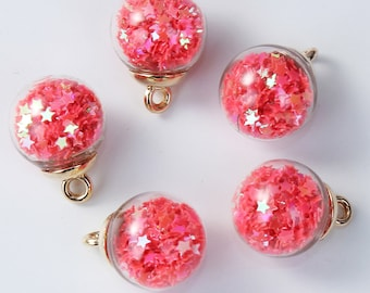 Charm / pendant glass globe filled with red stars