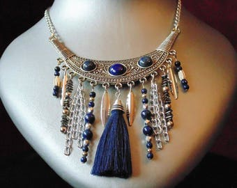 Necklace chain with a large silver connector.