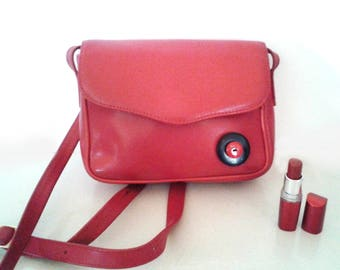 Red leather bag and its black and red buttons