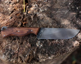 Forged in a rolling utility knife