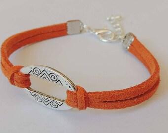 Oval shape connector ocher color suede bracelet