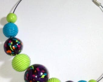 """Beaded necklace """"Confetti"""" in black and multicolor, turquoise blue polymer clay and pistachio Green made entirely by hand"""
