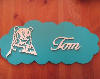 blue door with customizable bear
