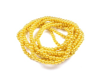 50 yellow Pearl glass beads approximately 4mm