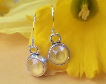 Sterling silver drop earrings with buttercup yellow Swarovski crystals in antique charm holders