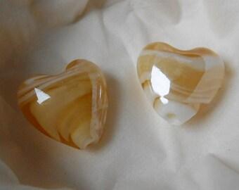 2 gold heart shaped glass beads