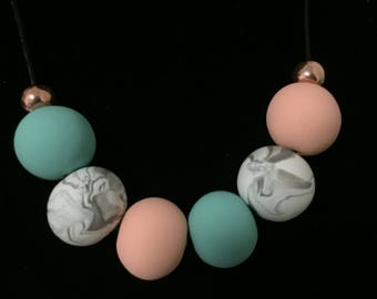 Handmade beads with mint green, peach and marble polymer clay necklace