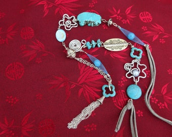Necklace turquoise, dyed howlite, silver suede light gray