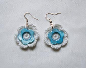pair of white and blue crochet earrings