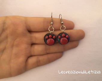 Red and black paw pendant earrings