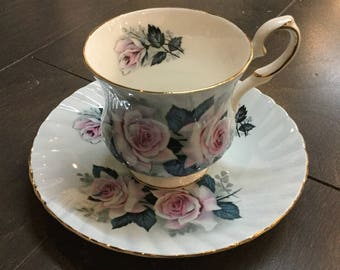 Elizabethan Bone China teacup with blue and pink roses