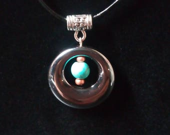 Hematite with Floating Turquoise dyed Howlite.