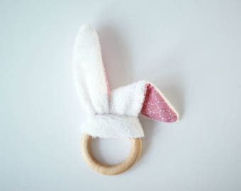 Rattle / Teether peeling wood tones bunny ears pink and white graphic pattern white