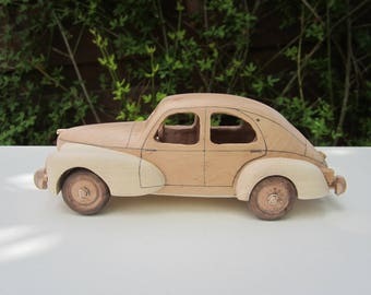 Wooden miniature of a Peugeot 203 pyracantha/Maple 1/24 scale.