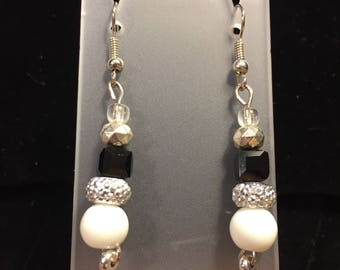 Drop earrings silver toned white and black.  2 inches long
