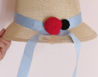 straw and paper hat
