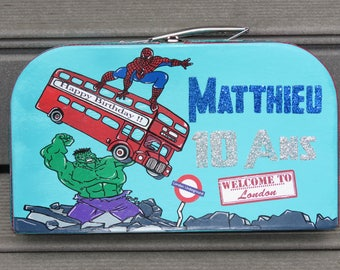Birthday box, suitcase, theme super hero, trip to London, Big ben, London bus, red, blue, red, customizable colors.