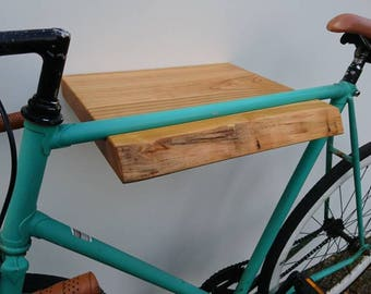 VéloPlanque-solid wood shelf to the (road) bicycle on the wall.