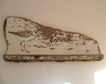 Painting of a gravelot on Driftwood from shipwreck