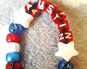 Red white and blue with stars dummy clip. Personalised
