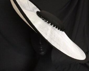 Monochrome hatinator with beading