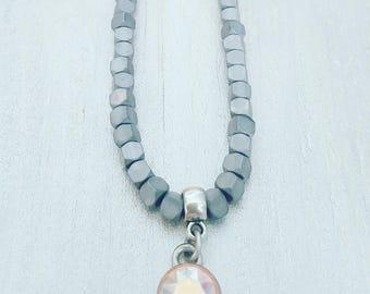 twentyonehappinezz • hemetite mineral stones necklace with swarovski charm.