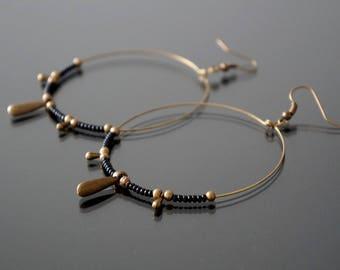 Black glass beads hoop earrings.
