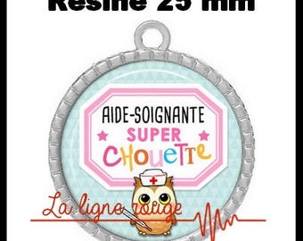 Pendant cabochon silver round 25 mm epoxy resin - the OWL using care (2248) - nurse, doctor, medical