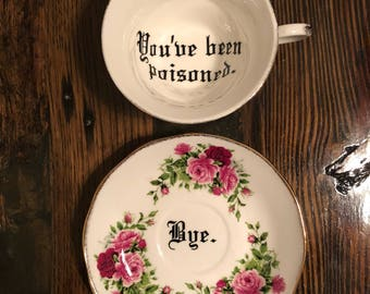 You've been poisoned. Vulgar tea cup with coordinating Bye. saucer