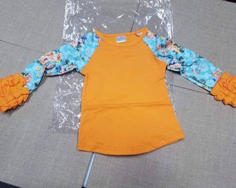 orange/blue floral raglan