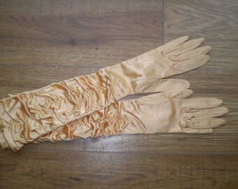 Vintage gold coloured evening gloves