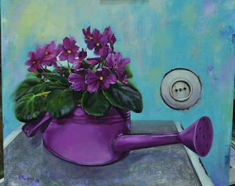 violets in watering can and rosette